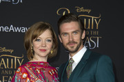 Actor Dan Stevens (R) and Susie Stevens attend the world premiere of Disney's Beauty and the Beast at El Capitan Theatre in Hollywood, California on March 2, 2017. / AFP PHOTO / VALERIE MACON