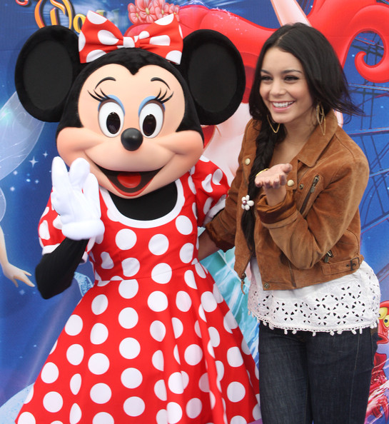 """Actress Vanessa Hudgens (R) and the Disney character Minnie Mouse attend the premiere of Disney California Adventure Park's """"World of Color"""" Spectacular on June 10, 2010 in Anaheim, California."""