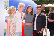 "(L-R) Actors Grace Phipps, Ross Lynch, Maia Mitchell and Garrett Clayton attend the premiere of Disney Channel's ""Teen Beach 2"" at Walt Disney Studios on June 22, 2015 in Burbank, California."