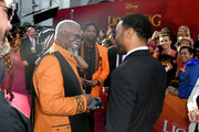 """(L-R) John Kani and Chiwetel Ejiofor attend the premiere of Disney's """"The Lion King"""" at Dolby Theatre on July 09, 2019 in Hollywood, California."""