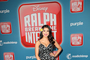 """Auli'i Cravalho attends the premiere of Disney's """"Ralph Breaks the Internet"""" at El Capitan Theatre on November 5, 2018 in Los Angeles, California."""