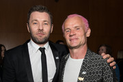 "Joel Edgerton and Flea attend the premiere of Focus Features; ""Boy Erased"" at Directors Guild Of America on October 29, 2018 in Los Angeles, California."