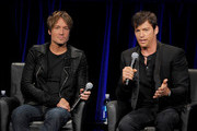 Musician Keith Urban (L) and singer Harry Connick Jr. appear onstage at the premiere of Fox's 'American Idol Xlll' at UCLA's Royce Hall on January 14, 2014 in Los Angeles, California.