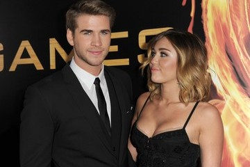 """Miley Cyrus Liam Hemsworth Premiere Of Lionsgate's """"The Hunger Games"""" - Red Carpet"""
