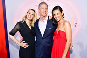 (L-R) Kate McKinnon, CEO of Lionsgate Jon Feltheimer, and Mila Kunis attend the premiere of Lionsgate's 'The Spy Who Dumped Me' at Fox Village Theater on July 25, 2018 in Los Angeles, California.