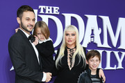 """Christina Aguilera, Matthew Rutler, Max Bratman and Summer Rain Rutler attend the premiere of MGM's """"The Addams Family"""" at Westfield Century City AMC on October 06, 2019 in Los Angeles, California."""