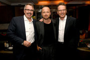 """(L-R) Vince Gilligan, Aaron Paul and Bryan Cranston pose at the after party for the premiere of Netfflix's """"El Camino: A Breaking Bad Movie"""" at Baltaire on October 07, 2019 in Los Angeles, California."""