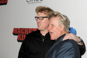 Actors Jake Busey (L) and Gary Busey arrive at the premiere of Open Road Films' 'Machete Kills' at Regal Cinemas L.A. Live on October 2, 2013 in Los Angeles, California.
