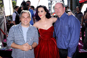 """President, Paramount Film Group Adam Goodman, singer/producer Katy Perry, and Vice Chairman Paramount Pictures Rob Moore arrive at the premiere of Paramount Insurge's """"Katy Perry: Part Of Me"""" held at Grauman's Chinese Theatre on June 26, 2012 in Hollywood, California."""