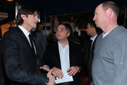 """(L-R) Actor Ashton Kutcher, President of Production at Paramount Pictures Adam Goodman and Paramount Pictures Vice Chairman Rob Moore arrive at Paramount Pictures' """"No Strings Attached"""" premiere at Regency Village Theater on January 11, 2011 in Westwood, California."""