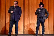 """(L-R) Executive Producer Jon Favreau and Executive Producer/Director Dave Filoni speak onstage at the premiere of Lucasfilm's first-ever, live-action series, """"The Mandalorian,"""" at the El Capitan Theatre in Hollywood, Calif. on November 13, 2019. """"The Mandalorian"""" streams exclusively on Disney+."""