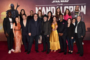 "(Back L-R) Rick Famuyiwa, Julia Jones, Omid Abtahi, Director Bryce Dallas Howard, Director Deborah Chow, Composer Ludwig Göransson, Emily Swallow, Brian Posehn, (Front L-R) Ming-Na Wen, Pedro Pascal, Executive Producer Jon Favreau, Executive Producer/Director Dave Filoni, Gina Carano, Carl Weathers, Executive Producer Kathleen Kennedy, Aidan Bertolav and Werner Herzog arrive at the premiere of Lucasfilm's first-ever, live-action series, ""The Mandalorian,"" at the El Capitan Theatre in Hollywood, Calif. on November 13, 2019. ""The Mandalorian"" streams exclusively on Disney+."