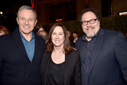 """(L-R) Disney CEO Bob Iger, Executive Producer Kathleen Kennedy and Executive Producer Jon Favreau arrive at the premiere of Lucasfilm's first-ever, live-action series, """"The Mandalorian,"""" at the El Capitan Theatre in Hollywood, Calif. on November 13, 2019. """"The Mandalorian"""" streams exclusively on Disney+."""