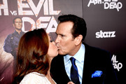 "Actor Bruce Campbell (L) and Ida Gearon arrive at the premiere of STARZ's ""Ash vs Evil Dead"" at the Chinese Theatre on October 28, 2015 in Los Angeles, California."