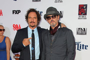 "Actor  Tommy Flanagan (R) and Kim Coates attends the Premiere Screening Of FX's ""Sons Of Anarchy"" at TCL Chinese Theatre on September 6, 2014 in Hollywood, California."