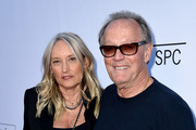 """Actor Peter Fonda (R) and his wife Parky DeVogelaere arrive at the premiere of Sony Pictures Classics' """"Boundaries"""" at the American Cinematheque's Egyptian Theatre on June 19, 2018 in Los Angeles, California."""