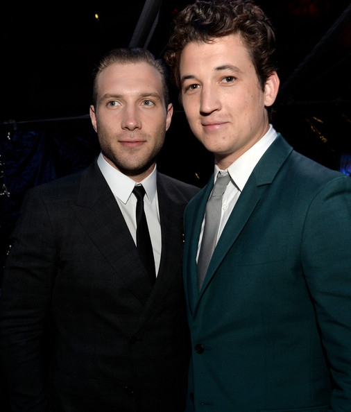 "Actors Jai Courtney (L) and Miles Teller pose at the after party for the premiere of Summit Entertainment's ""Divergent"" at The Armand Hammer Museum on March 18, 2014 in Los Angeles, California."