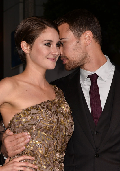 "Actors Shailene Woodley (L) and Theo James arrive at the premiere of Summit Entertainment's ""Divergent"" at the Regency Bruin Theatre on March 18, 2014 in Los Angeles, California."