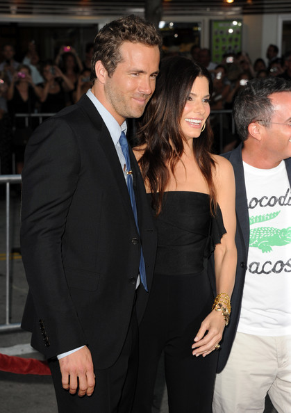 "Actors Ryan Reynolds (L) and Sandra Bullock arrive at the premiere of Universal Pictures' ""The Change-Up"" held at the Regency Village Theatre on August 1, 2011 in Los Angeles, California."