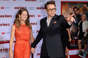 Actor Robert Downey Jr. and his wife, Susan Downey attend the premiere of Walt Disney Pictures' 'Iron Man 3' at the El Capitan Theatre on April 24, 2013 in Hollywood, California.
