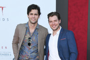 Matt Daddario and Dominic Sherwood attend the Premiere Of Warner Bros. Pictures' 'It Chapter Two' at Regency Village Theatre on August 26, 2019 in Westwood, California.