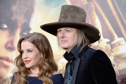 """Singer Lisa Marie Presley (L) and musician Michael Lockwood attend the premiere of Warner Bros. Pictures' """"Mad Max: Fury Road"""" at TCL Chinese Theatre on May 7, 2015 in Hollywood, California."""