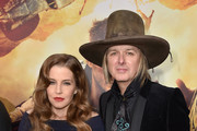 """Lisa Marie Presley (L) and musician Michael Lockwood attend the premiere of Warner Bros. Pictures' """"Mad Max: Fury Road"""" at TCL Chinese Theatre on May 7, 2015 in Hollywood, California."""