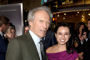 """Clint Eastwood (L) and Kristina Rivera pose at the premiere of Warner Bros. Pictures' """"The Mule"""" at the Village Theatre on December 10, 2018 in Los Angeles, California."""