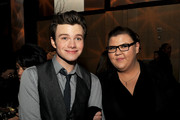 """Actors Chris Colfer (L) and Ashley Fink pose at the after party for the premiere of Warner Bros. Pictures' """"New Year's Eve"""" at Hollywood and Highland on December 5, 2011 in Los Angeles, California."""