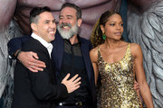 "(L-R) Director Brad Peyton, actors Jeffrey Dean Morgan and Naomie Harris arrive at the premiere of Warner Bros. Pictures' ""Rampage"" at the Microsoft Theatre on April 4, 2018 in Los Angeles, California."