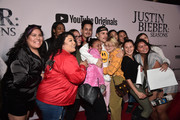 """Justin Bieber (C) and fans  attend the premiere of YouTube Original's """"Justin Bieber: Seasons"""" at Regency Bruin Theatre on January 27, 2020 in Los Angeles, California."""