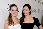 Actress/producer Hilary Swank (L) and actress Emmy Rossum arrive at the premiere of eOne Films' 'You're Not You' at the Vanguard Theatre on October 8, 2014 in Los Angeles, California.