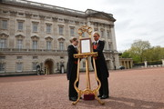 Senior footman Olivia Smith (L) and footman Heather McDonald place a notice on an easel in the forecourt of Buckingham Palace in London to formally announce the birth of a baby boy to the Duke and Duchess of Cambridge at the Lindo Wing of St Mary's Hospital on April 23, 2018 in London, England.  The Duchess safely delivered a son at 11:01 am, weighing 8lbs 7oz, who will be fifth in line to the throne.