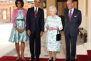US President Barack Obama, first lady Michelle Obama, Queen Elizabeth II and Prince Philip, Duke of Edinburgh pose for a photograph as they arrive to Buckingham Palace on May 24, 2011 in London, England. The 44th President of the United States, Barack Obama, and his wife Michelle are in the UK for a two day State Visit at the invitation of HM Queen Elizabeth II. During the trip they will attend a state banquet at Buckingham Palace and the President will address both houses of parliament at Westminster Hall.