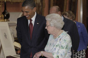 Queen Elizabeth II shows U.S. President Barack Obama an exhibition of American items from The Royal Collection, in the Picture Gallery of  Buckingham Palace on May 24, 2011 in London, England. The 44th President of the United States, Barack Obama, and his wife Michelle are in the UK for a two day State Visit at the invitation of HM Queen Elizabeth II. During the trip they will attend a state banquet at Buckingham Palace and the President will address both houses of parliament at Westminster Hall.