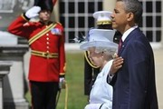 Queen Elizabeth II and US President Barack Obama stand to listen to the US National Anthem during a ceremonial welcome in the garden of Buckingham Palace on May 24, 2011 in London, England. The 44th President of the United States, Barack Obama, and his wife Michelle are in the UK for a two day State Visit at the invitation of HM Queen Elizabeth II. During the trip they will attend a state banquet at Buckingham Palace and the President will address both houses of parliament at Westminster Hall.