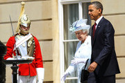 Queen Elizabeth II walks with US President Barack Obama before he reviews an honour guard with Prince Philip, Duke of Edinburgh at Buckingham Palace on May 24, 2011 in London, England. The 44th President of the United States, Barack Obama, and his wife Michelle are in the UK for a two day State Visit at the invitation of HM Queen Elizabeth II. During the trip they will attend a state banquet at Buckingham Palace and the President will address both houses of parliament at Westminster Hall.