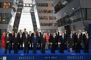 (Front row from L) Canadian Prime Minister Justin Trudeau, Bulgaria's President Rumen Radev, Albanian Prime Minister Edi Rama, Belgian Prime Minister Charles Michel, King Philippe - Filip of Belgium, NATO Secretary General Jens Stoltenberg, US President Donald Trump, Britain's Prime Minister Theresa May, Turkish President Recep Tayyip Erdogan, Spanish Prime Minister Mariano Rajoy, (second row from L) Croatian President Kolinda Grabar-Kitarovic, Czech President Milos Zeman, Danish Prime Minister Lars Lokke Rasmussen, Estonia's Prime Minister Juri Ratas, French President Emmanuel Macron, German Chancellor Angela Merkel, Greek Prime Minister Alexis Tsipras, Hungary's Prime Minister Viktor Orban, Iceland's Prime Minister Bjarni Benediktsson, Italian Prime Minister Paolo Gentiloni, Latvia's President Raimonds Vejonis, (third row from L) Lituania's President Dalia Grybauskaite, Luxembourg's Prime Minister Xavier Bettel, Dutch Prime Minister Mark Rutte, Norway's Prime Minister Erna Solberg, Polish President Andrzej Duda, Portuguese Prime Minister Antonio Costa, Romanian President Klaus Werner Iohannis, Slovakia's President Andrej Kiska, Slovenian Prime Minister Miro Cerar and Montenegro's Prime Minister Dusko Markovic pose for a family picture during the NATO (North Atlantic Treaty Organization) summit at the NATO headquarters, in Brussels, on May 25, 2017. / AFP PHOTO / Eric FEFERBERG