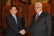In this handout image provided by the Palestinian Press Office, Vietnam's President Nguyen Minh Triet shakes hands with Palestinian President Mahmoud Abbas during a Welcoming Ceremy at the Presidential Palace on May 25, 2010 in Hanoi, Vietnam. Abbas is in Vietnam on a official visit from May 24 to 26.