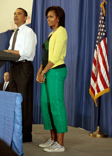 U.S. President Barack Obama (L) delivers remarks with first lady Michelle Obama.