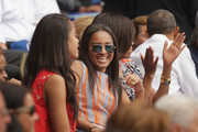 (L-R) Malia Obama, Sasha Obama, U.S. first lady Michelle Obama and President Barack Obama react to the first run scored during an exhibition game between the Cuban national baseball team and Major League Baseball's Tampa Bay Devil Rays at the Estado Latinoamericano March 22, 2016 in Havana, Cuba. This is the first time a sittng president has visited Cuba in 88 years.