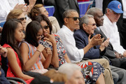 (L-R) Malia Obama, Sasha Obama, U.S. first lady Michelle Obama, President Barack Obama and Cuban President Raul Castro react to the first run scored during an exhibition game between the Cuban national baseball team and Major League Baseball's Tampa Bay Devil Rays at the Estado Latinoamericano March 22, 2016 in Havana, Cuba. This is the first time a sittng president has visited Cuba in 88 years.
