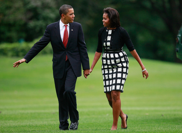 US President Barack Obama and his wife first lady Michelle Obama walk on the south lawn after arriving back at the White House on October 2, 2009 in Washington, DC. President Obama later spoke to the media about his trip to Copenhagen to lend support to Chicago to host the 2016 Summer Olympics games which was announced today to be held in Rio de Janeiro instead.