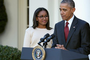 U.S. President Barack Obama (R) and his daughter Sasha Obama participate in the turkey pardoning ceremony in the Rose Garden at the White House  November 25, 2015 in Washington, DC. In a tradition dating back to 1947, the president pardons a turkey, sparing the tom -- and his alternate -- from becoming a Thanksgiving Day feast. This year, Americans were asked to choose which of two turkeys would be pardoned and to cast their votes on Twitter.