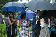 (L-R) Sasha Obama, 14, first lady Michelle Obama, U.S. President Barack Obama and Malia Obama, 17, pause to look at a statue of Cuban independence hero Carlos Manuel de Cespedes during a walking tour of the plaza of the 18th century Catedral de San Cristobal de la Habana in the Old Havana neighborhood March 20, 2016 in Havana, Cuba. Obama is the first sitting president to visit Cuba in nearly 90 years.