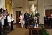 Coach Cheryl Reeve (L) and US President Barack Obama arrive for an event to celebrate the 2015 WNBA Champions, Minnesota Lynx, in the East Room of the White House June 27, 2016 in Washington, DC. / AFP / Brendan Smialowski