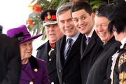 HM Queen Elizabeth II smiles along with Prime Minister Gordon Brown, David Miliband and Alan Johnson during a ceremonial welcome for South Africa President Jacob Zuma on Horseguards Parade on March 3, 2010 in London, England. The South African Leader is on a three day State visit to Britain.
