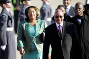 South African President Jacob Zuma (second right) and Thobeka Madiba Zuma, his newest of three wives, arrive at Heathrow airport on March 2, 2010 in London, England. Mr Zuma and his wife are beginning a three-day state visit to the UK during which they are due to meet the Queen at Buckingham Palace and visit the Olympic Park site.