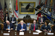 (AFP OUT) U.S. President Donald J. Trump, center left, flanked by Director of National Economic Council Larry Kudlow, center right, Transportation Secretary Elaine Chao, right, and Ford Motor Company CEO James Hackett, left, speaks with reporters during a meeting with automotive industries executives in the Roosevelt Room of the White House on May 11, 2018 in Washington, DC.