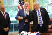 U.S. President Donald Trump pretends to give a red card to members of the news media while meeting with FIFA President Gianni Infantino (C) and U.S. Soccer President Carlos Cordeiro in the Oval Office at the White House August 28, 2018 in Washington, DC. The 2026 FIFA World Cup will be jointly hosted by the United States, Canada and Mexico and will be the first World Cup in history to be held in three countries at the same time.